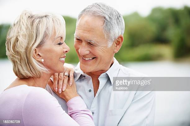 Romantic mature man and woman looking at each other