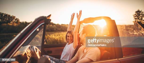 Romantic moments in sunset on a road trip