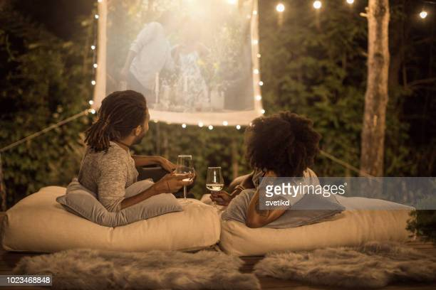 romantic movie night - projection equipment stock pictures, royalty-free photos & images