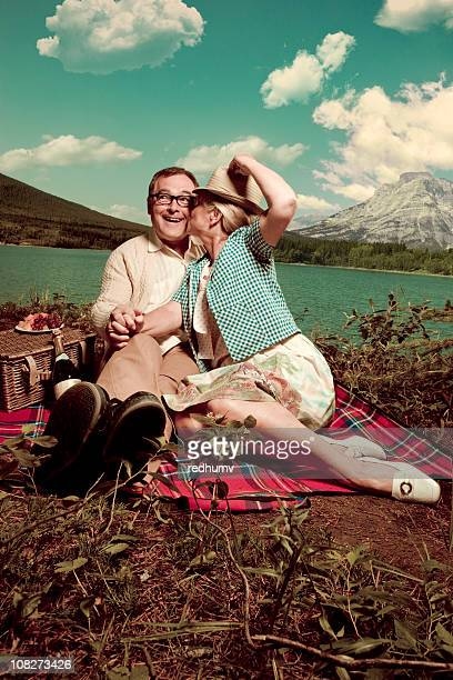 romantic picnic kiss at the lake - copulation of humans stock photos and pictures