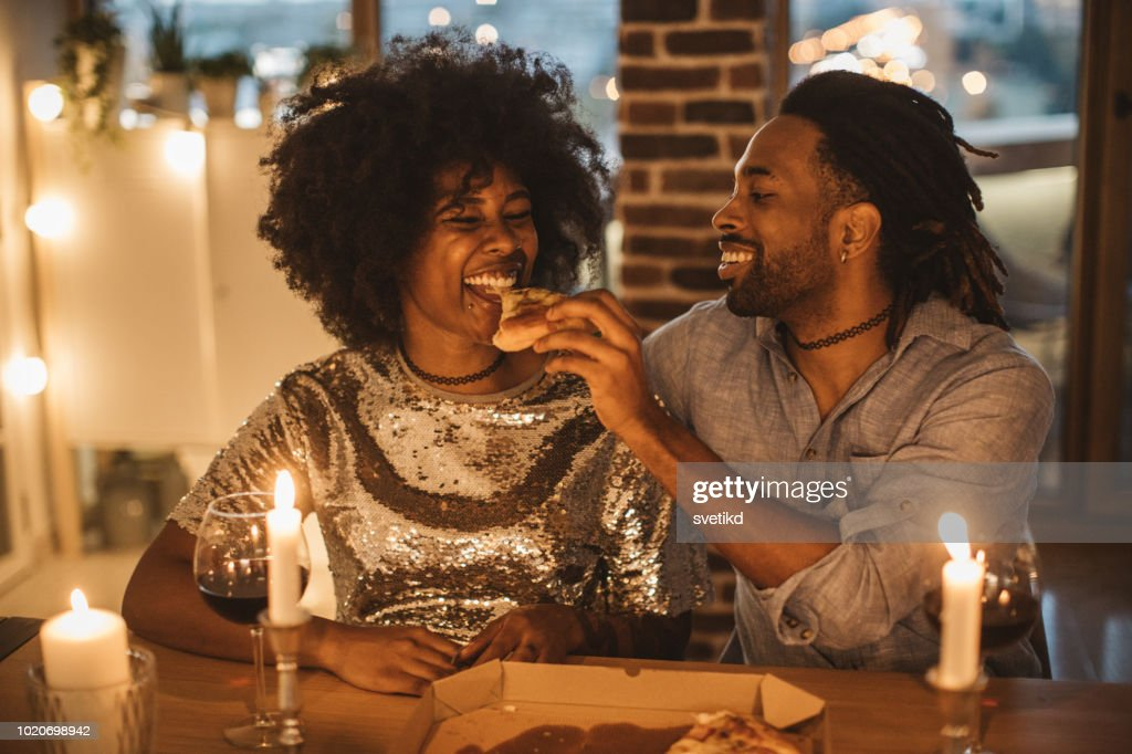 Romantic pizza evening at home : Stock Photo