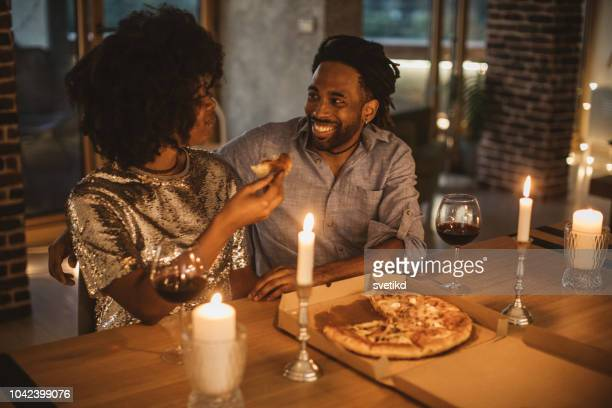 romantic pizza evening at home - romanticism stock pictures, royalty-free photos & images