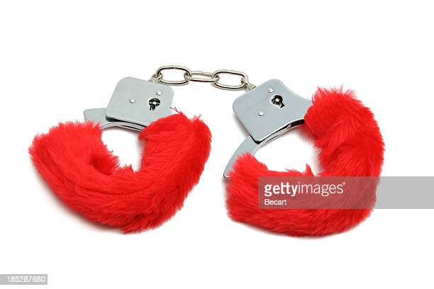 romantic red handcuffs - sex toy stock photos and pictures