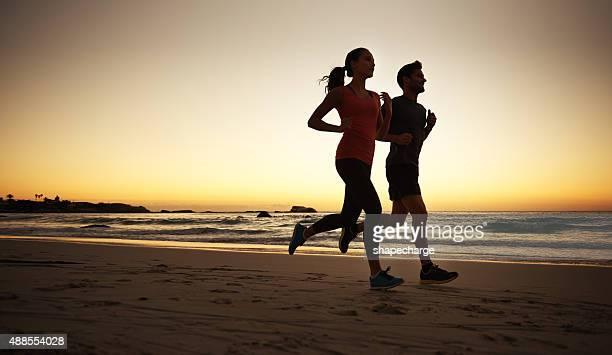 Romantic runs by sunset