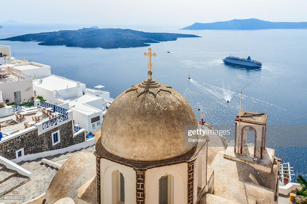 Romantic Santorini island with traditional Greek whitewashed architecture : Stock Photo