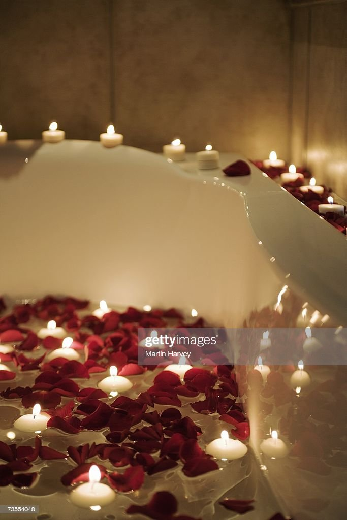 Romantic Scene Of Candles And Rose Petals In Bath Stock