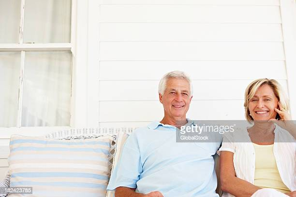 Romantic senior couple spending time together on a couch