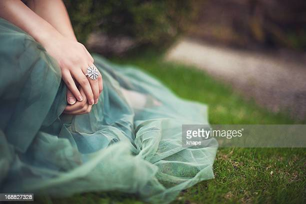 romantic setting with hands and tulle dress - green dress stock pictures, royalty-free photos & images