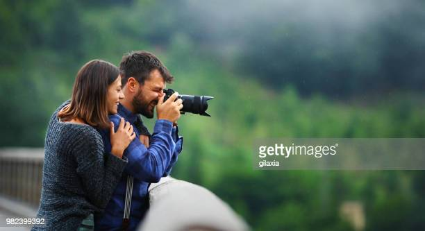 romantic sightseeing. - pointing at camera stock photos and pictures