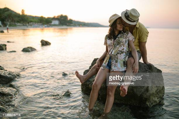 romantic summer vacation - mid adult couple stock pictures, royalty-free photos & images