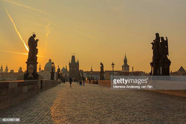 Romantic sunrise view on the Charles Bridge with the towers and spires of the Old Town beyond, Prague, Czech Republic
