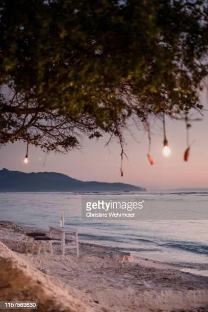 romantic sunset beachside view on gili trawangan - christine wehrmeier stock pictures, royalty-free photos & images