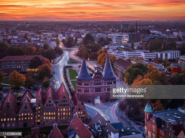 romantic sunset over luebeck - schleswig holstein stock-fotos und bilder