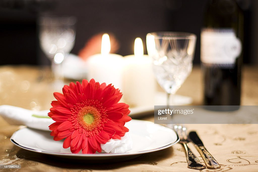 A romantic table for two with a red flower : Stock Photo