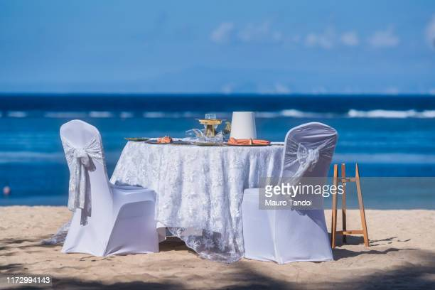 romantic table in bali, indonesia - mauro tandoi stock photos and pictures