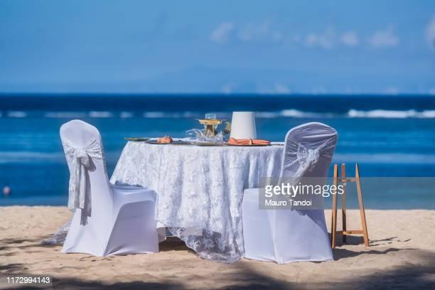 romantic table in bali, indonesia - mauro tandoi ストックフォトと画像