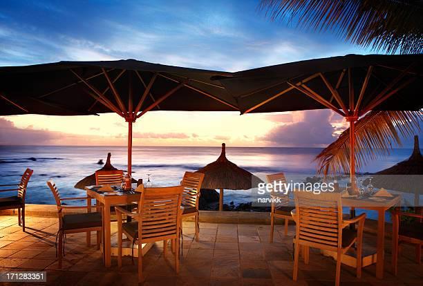 Romantic terrace on the beach by twilight