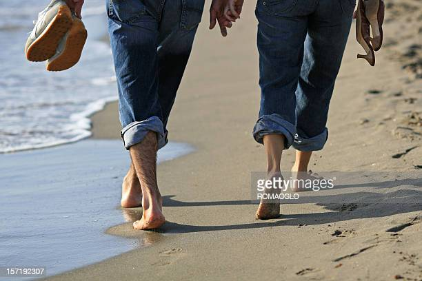 Romantic walk on the beach in Italy