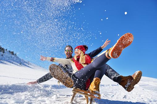 romantic winter scene, happy young couple having fun on fresh show on winter vacatio, mountain nature landscape 903984854
