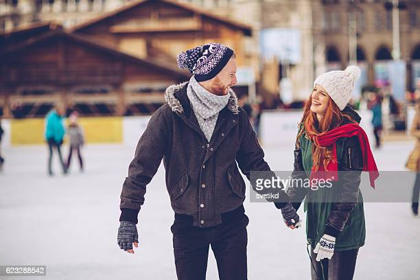 romantic winter vacation - ice skate stock pictures, royalty-free photos & images