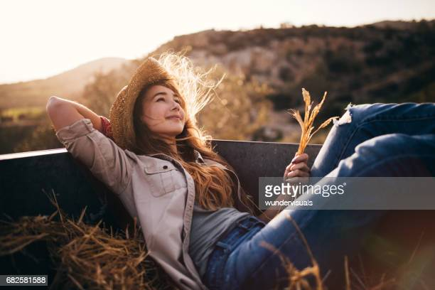 Romantic woman daydreaming in the back of a vintage truck