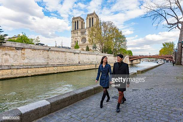 romantic young asian couple in love on vacation in paris - river seine stock pictures, royalty-free photos & images