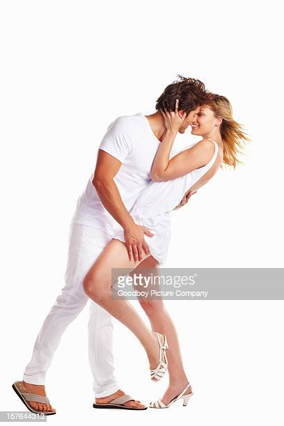 Romantic young couple against white