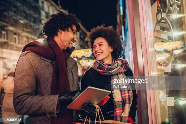 Romantic young couple buying Christmas presents online