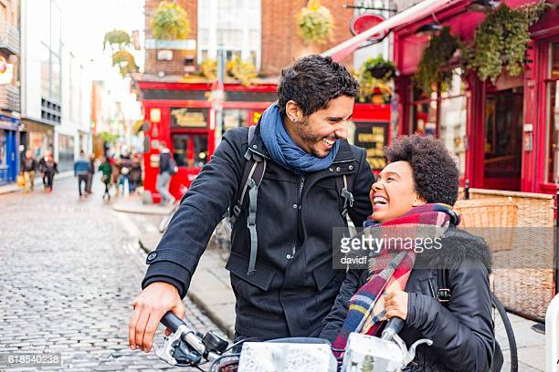 romantic young couple christmas shopping in temple bar dublin ireland - dublin stock pictures, royalty-free photos & images