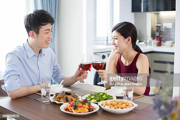 Romantic young couple dining at home