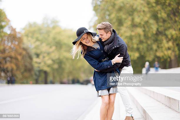 Romantic young couple fooling around in park, London, England, UK