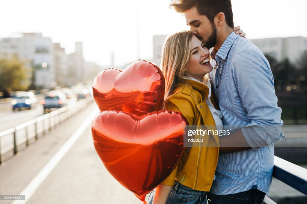 Romantic young couple in love, hugging on the street : Stock Photo
