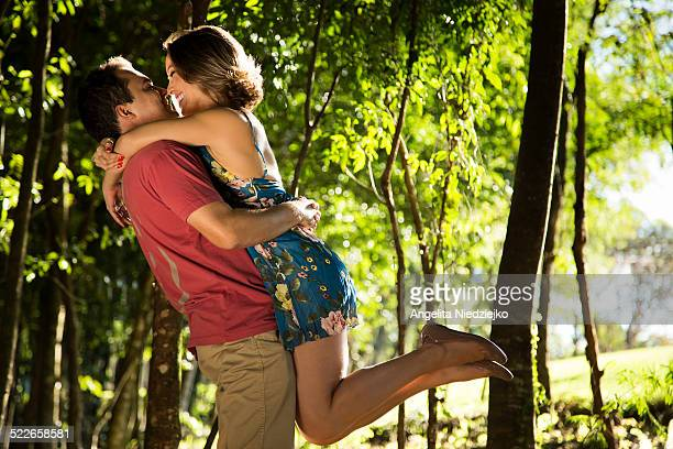 Romantic young couple in the forest