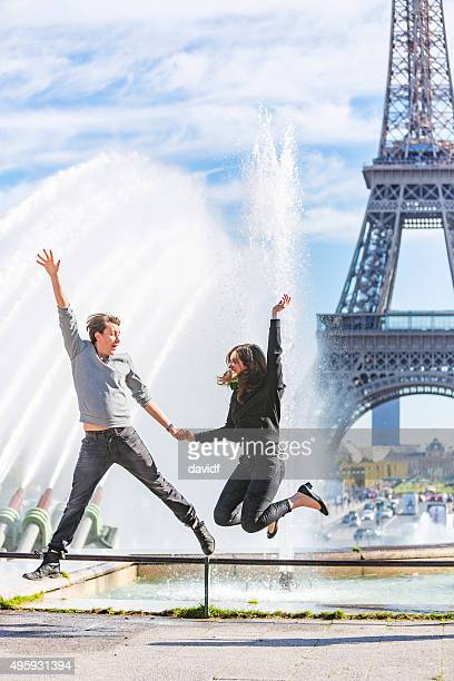 Romantic Young Couple Jumping at the Eiffel Tower, Paris, France