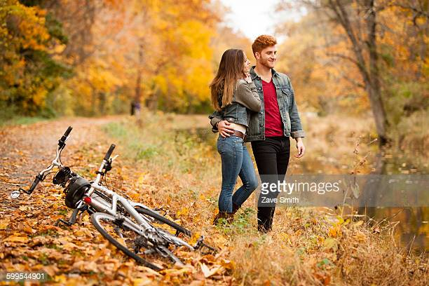Romantic young couple on riverside in autumn