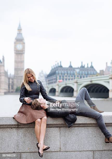 Romantic young couple on wall in front of Big Ben, London, England, UK