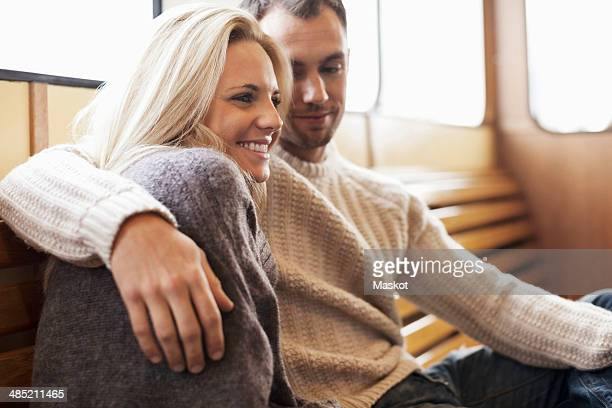 Romantic young couple sitting on ferry