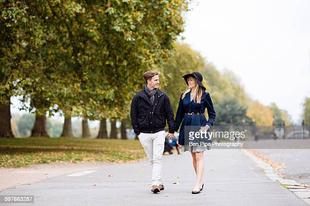 Romantic young couple strolling in park, London, England, UK