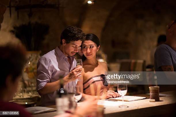romantic young couple together in winery - napa valley stock pictures, royalty-free photos & images