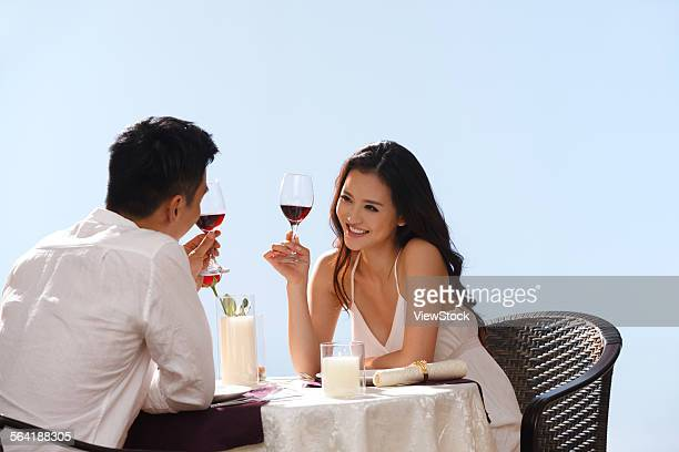 Romantic young lovers in the seaside dining