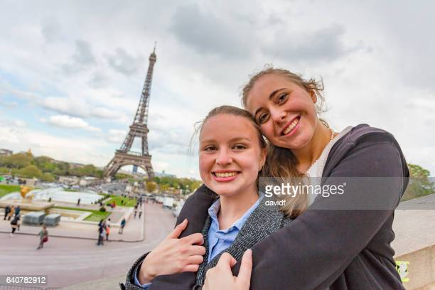 Romantic Young Women Couple Hugging by the Eiffel Tower in Paris