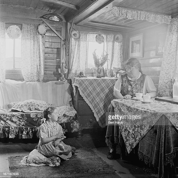 A Romany woman and girl in their caravan on an encampment at Corke's Meadow in Kent July 1951 Original publication Picture Post 5363 The Unromantic...