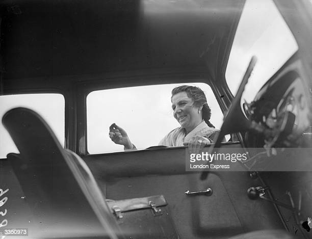 Romany woman, Rose Lee, selling lucky charms to motorists during Derby week at Epsom.