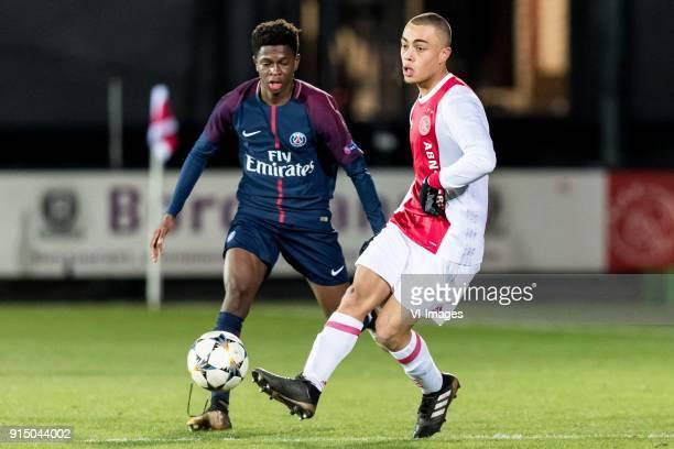 Romaric Yapi of Paris SaintGermain U19 Sergino Dest of Ajax U19 during the UEFA Youth League play off match between Ajax U19 and Paris Saint Germain...
