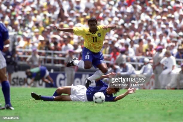 Romarid Brazil leaps over Antonio Benarrivo Italy
