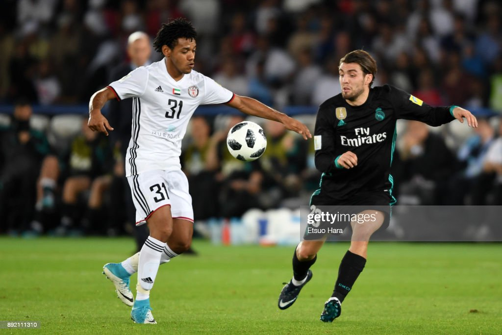 Romarinho (L) of Al Jazira and Mateo Kovacic of Real Madrid compete for the ball during the FIFA Club World Cup UAE 2017 semi-final match between Al Jazira and Real Madrid on December 13, 2017 in Abu Dhabi, United Arab Emirates.