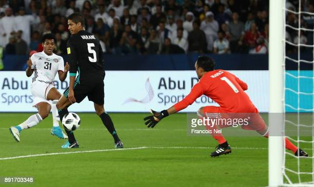 Romarinho of Al Jazira scores his sides first goal during the FIFA Club World Cup UAE 2017 semifinal match between Al Jazira and Real Madrid on...