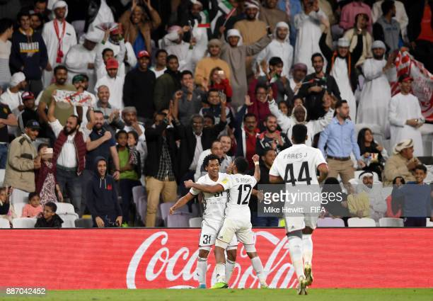 Romarinho of AlJazira celebrates after scoring his sides first goal with Salim Rashid of AlJazira during the FIFA Club World Cup UAE 2017 play off...