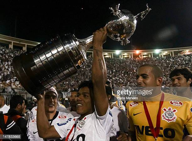 Romarinho of Corinthians celebrates a title with the cup after the second leg of the final of the Copa Libertadores 2012 between Boca Juniors of...