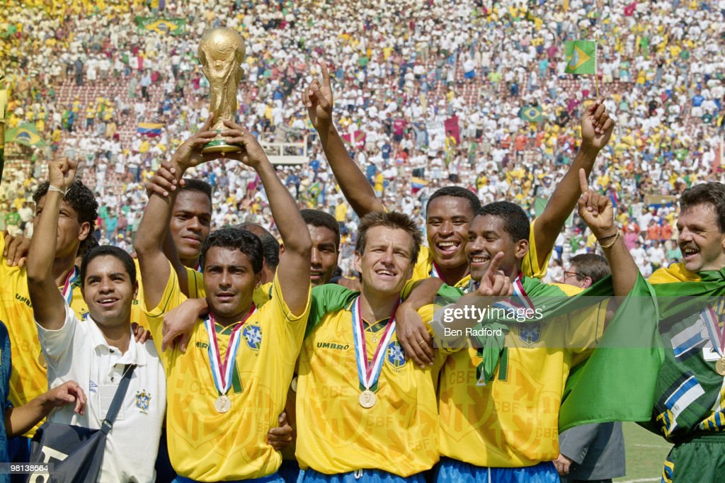 Romario (with trophy) and captain Dunga of Brazil and the Brazilian team celebrate after winning the1994 FIFA World Cup Final against Italy on 17 July 1994 played at the Rose Bowl in Pasadena, California, United States. Brazil defeated Italy 3-2 in a penalty shootout.